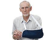 Senior man ith painful arm in sling